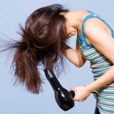 Woman blowdrying hair